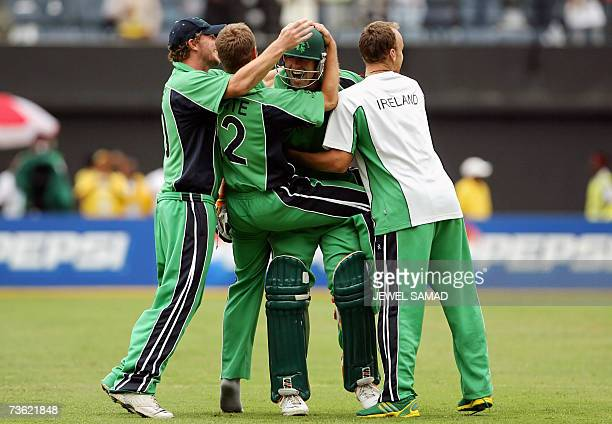 Irish cricket team captain Trent Johnston embraces teammates as they celebrate their victory over Pakistan at the end of the Group D match of the ICC...