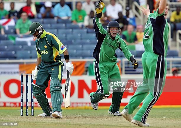 Irish cricket team wicketkeeper Niall O'Brien successfully takes a catch to dismiss Pakistani batsman Shoaib Malik off his brother Kevin O'Brien...