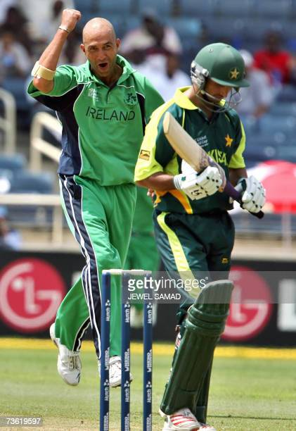 Irish cricketer Andre Botha gestures as he gets airborne after dismissing Pakistani batsman Imran Nazir during their Group D match of the ICC World...