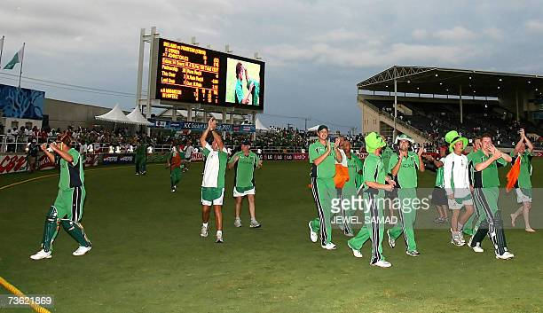 Irish cricketer celebrate their victory over Pakistan at the end of the Group D match of the ICC World Cup 2007 between Ireland and Pakistan at the...