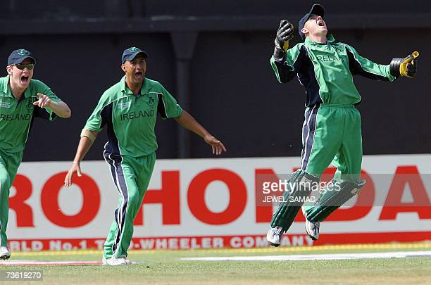 Irish cricketer Niall O'Brien gets airborne in celebration after taking a catch to dismiss Pakistani batsman Younis Khan during their Group D match...