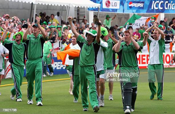 Irish cricketers celebrate their victory over Pakistan at the end of the Group D match of the ICC World Cup 2007 between Ireland and Pakistan at the...