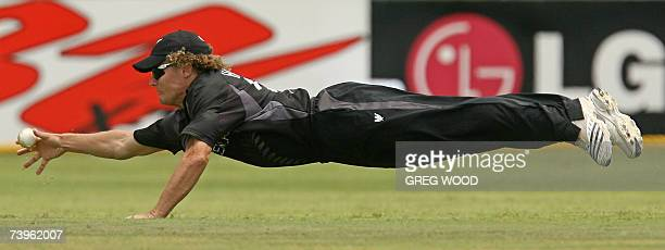 New Zealand cricketer Hamish Marshall dives for a catch as he fields against Sri Lanka during the ICC Cricket World Cup 2007 semi-final match at the...