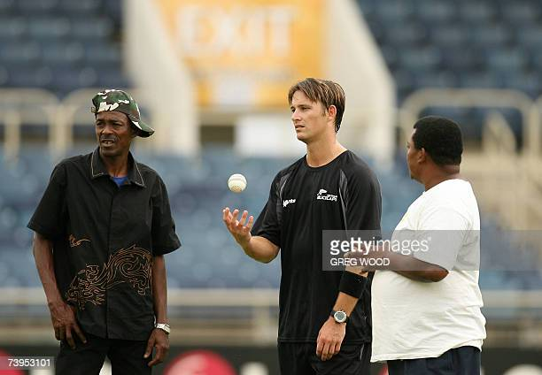 New Zealand cricketer Shane Bond talks with groundsmen during a training session at the Sabina Park cricket stadium in Kingston in Jamaica, 23 April...