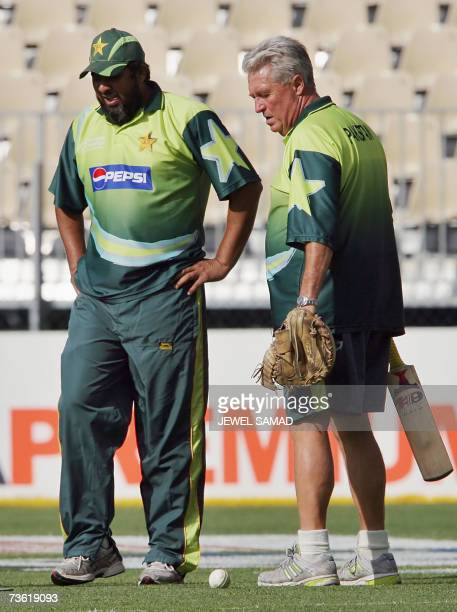 Pakistani cricket team captain Inzamam-ul-Haq and coach Bob Woolmer inspect the crease before the Group D match of the ICC World Cup 2007 between...