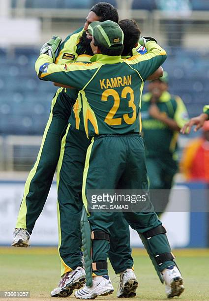 Pakistani cricketer Mohammad Yousuf is hugged by teammates after dismissing the last wicket of Zimbabwe during the Group D match of the ICC World Cup...