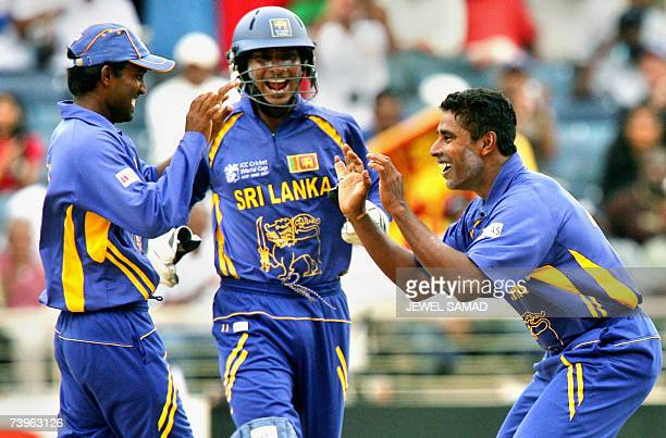 Sri Lankan bowler Chaminda Vaas celebrates with teammates after dismissing New Zealand's batsman Ross Taylor during the ICC World Cup 2007 semi-final...
