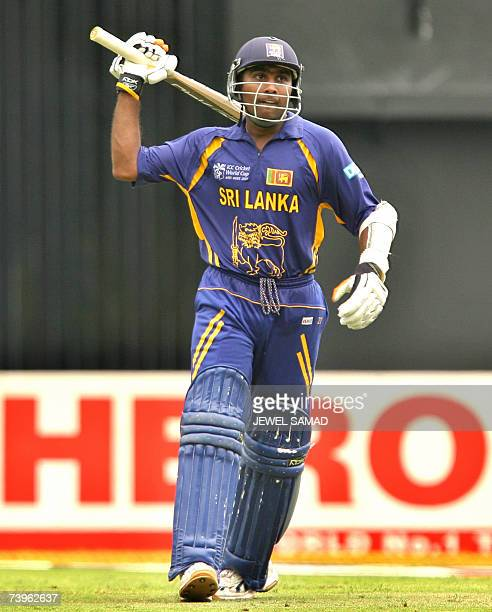 Sri Lankan captain Mahela Jayawardene celebrates after completing his century during the ICC World Cup 2007 semi-final match between New Zealand and...