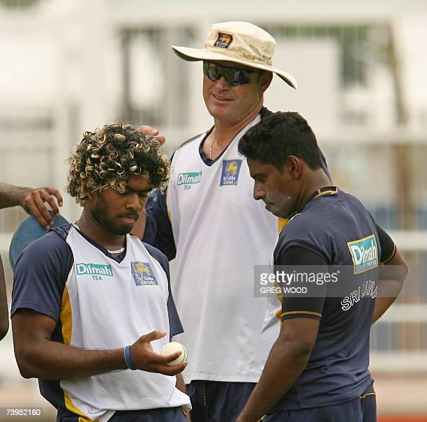 Sri Lankan cricketer Lasith Malinga talks with Chaminda Vaas and coach Tom Moody during a training session at Sabina Park staduim in Kingston in...