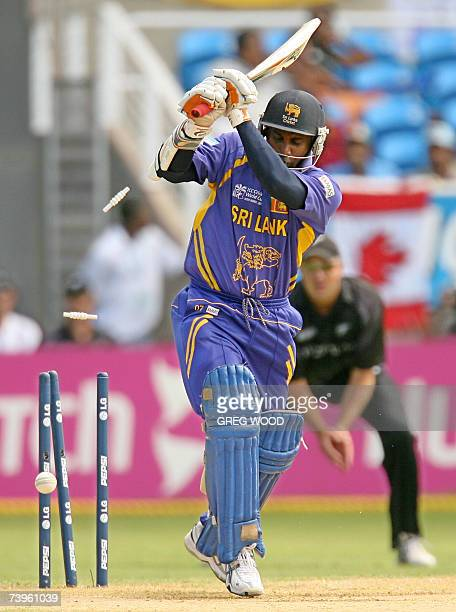 Sri Lankan cricketer Sanath Jayasuriya is clean bowled off the bowling of New Zealand's James Franklin during the ICC Cricket World Cup 2007...