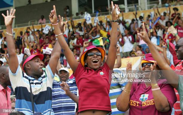 Supporters of the West Indies cricket team celebrate at Sabina Park in Kingston Jamaica 19 March 2007 as their team beat Zimbabwe to qualify for the...