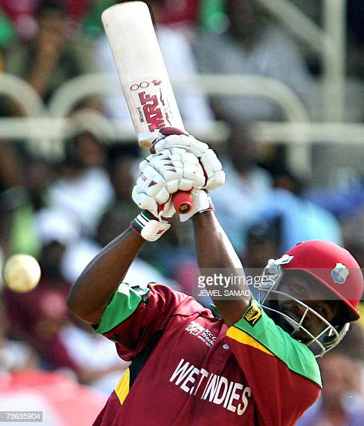 West Indies cricket captain Brian Lara hits a boundary off Zimbabwe's counterpart Prosper Utseya during their ICC World Cup Cricket 2007 Group B...