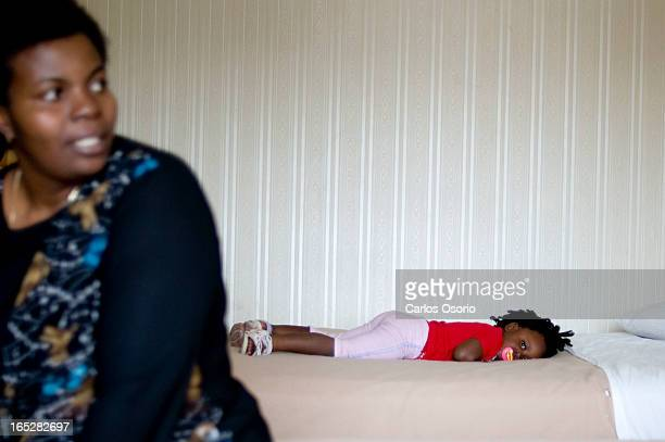 Kingston Road Residents -- Noela is seen lying on her bed at the Howard Johnson where they live at Warden and the 401 while her mom, Perpetua Evans...