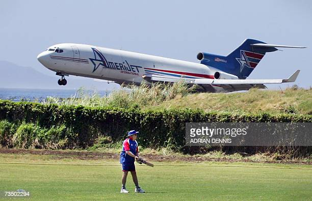 Kingstown, SAINT VINCENT AND THE GRENADINES: A jet comes in to land at E.T. Joshua Airport beside Sion Hill cricket ground where England's cricket...