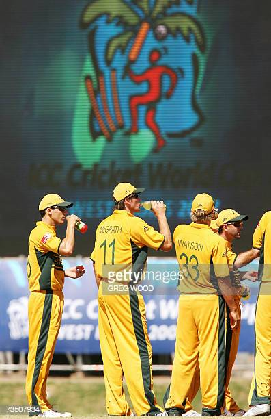 Kingstown, SAINT VINCENT AND THE GRENADINES: Australian bowler Glenn McGrath and his teammates have a drink during the Cricket World Cup warmup match...