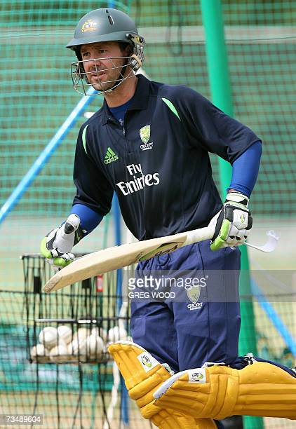 Kingstown, SAINT VINCENT AND THE GRENADINES: Australian cricket Captain Ricky Ponting jogs into position to bat during his team's training session at...