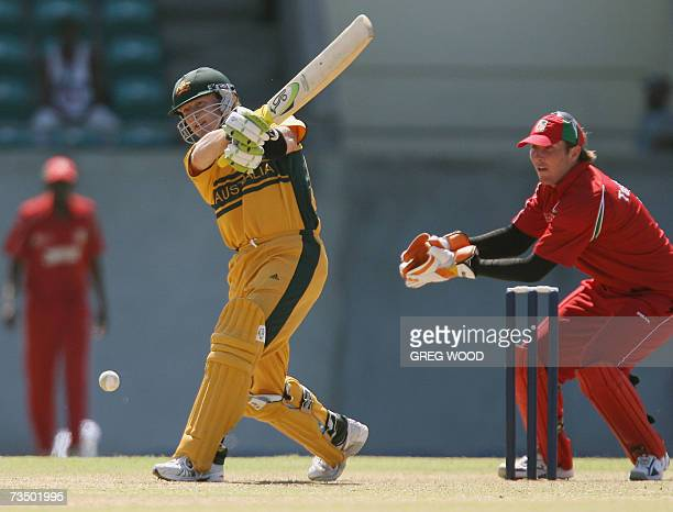Kingstown, SAINT VINCENT AND THE GRENADINES: Australian cricketer Brad Haddin watched by Zimbabwe wicketkeeper Brendan Taylor pulls the ball to the...