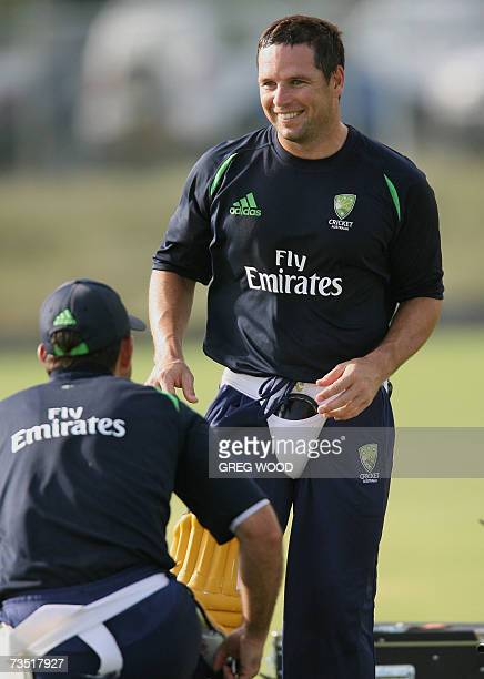Kingstown, SAINT VINCENT AND THE GRENADINES: Australian cricketer Brad Hodge laughs with a teammate after completing a batting training session on...