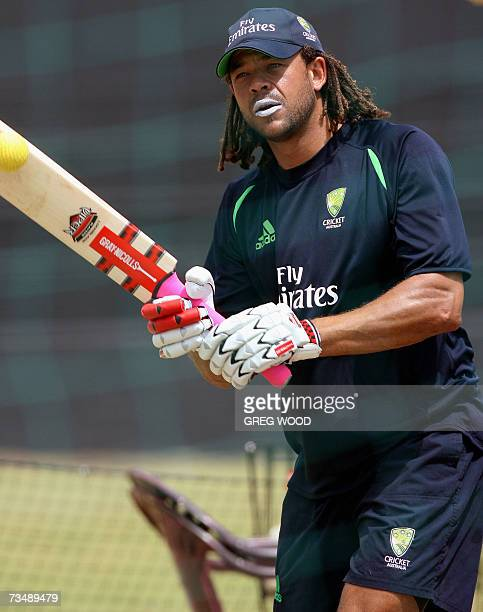 Kingstown, SAINT VINCENT AND THE GRENADINES: Australian cricketer Andrew Symonds hits the ball back as he trains with teammates at the Stubbs Playing...