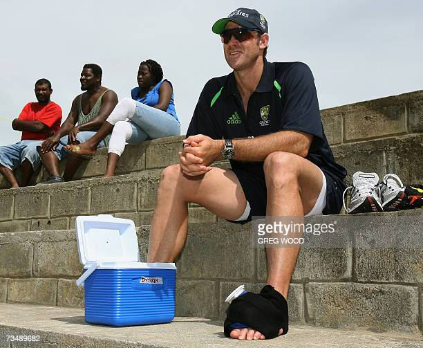 Kingstown SAINT VINCENT AND THE GRENADINES Australian cricketer Matthew Hayden sits with his left foot in an icepack and his right foot in an iced...