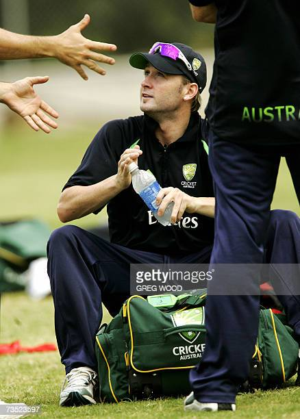Kingstown, SAINT VINCENT AND THE GRENADINES: Australian cricketer Michael Clarke speaks with teammates during a training session on the Caribbean...