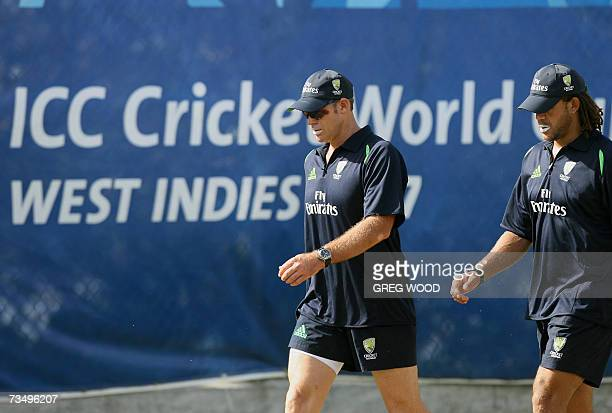 Kingstown, SAINT VINCENT AND THE GRENADINES: Australian World Cup cricketers Matthew Hayden and Andrew Symonds walk around the ground during a...
