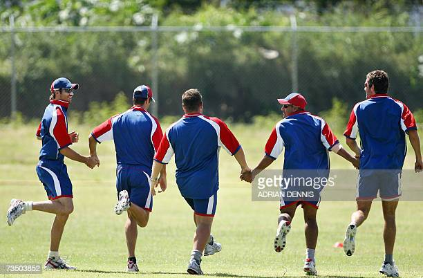 Kingstown SAINT VINCENT AND THE GRENADINES England players James Anderson Captain Michael Vaughan Ravi Bopara and Liam Plunkett hold hands while they...