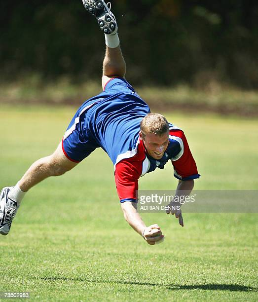 Kingstown, SAINT VINCENT AND THE GRENADINES: England's Andrew Flintoff dives to take a catch during a training exercise at Sion Hill cricket ground...