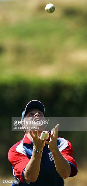 Kingstown, SAINT VINCENT AND THE GRENADINES: England's Andrew Flintoff keeps his eye on the ball to make a catch during training at Sion Hill cricket...
