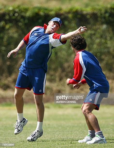Kingstown, SAINT VINCENT AND THE GRENADINES: England's Andrew Flintoff reaches for a catch beside England's Jon Lewis during training at Sion Hill...