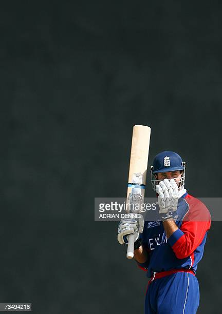 Kingstown, SAINT VINCENT AND THE GRENADINES: England's Captain Michael Vaughan adjusts his helmet during the warm-up match against Bermuda at Arnos...