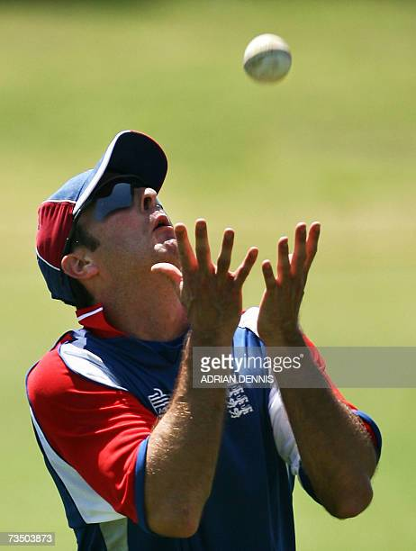 Kingstown, SAINT VINCENT AND THE GRENADINES: England's Captain Michael Vaughan keeps his eye on the ball to make a catch during training at Sion Hill...