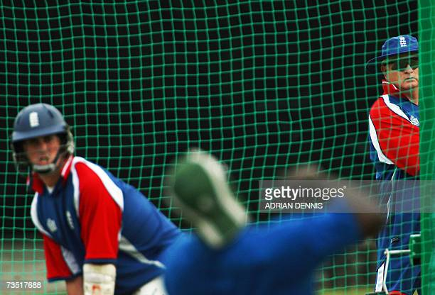 Kingstown, SAINT VINCENT AND THE GRENADINES: England's Coach Duncan Fletcher watches over Jon Lewis in the batting nets during a team training...