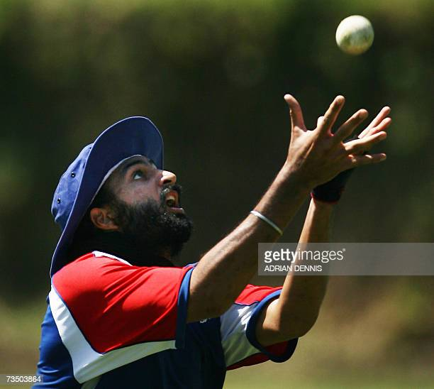 Kingstown, SAINT VINCENT AND THE GRENADINES: England's Monty Panesar keeps his eye on the ball to make a catch during training at Sion Hill cricket...