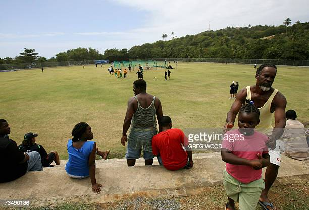 Kingstown, SAINT VINCENT AND THE GRENADINES: Locals watch the Australian cricket team train at the Stubbs Playing Field on the Eastern Caribbean...