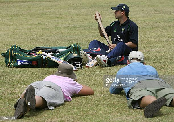 Kingstown, SAINT VINCENT AND THE GRENADINES: Two photographers photograph Australian cricketer Brad Hodge during a training session at the Stubbs...