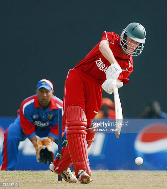 Kingstown, SAINT VINCENT AND THE GRENADINES: Zimbabwe's Sean Williams plays a shot against Bermuda at Arnos Vale sports ground during the warm-up...