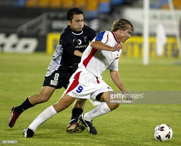Kingz Patricio Almendra and Newcastle Uniteds Joel Griffiths compete for the ball during the NSL soccer match between the Football Kingz and...
