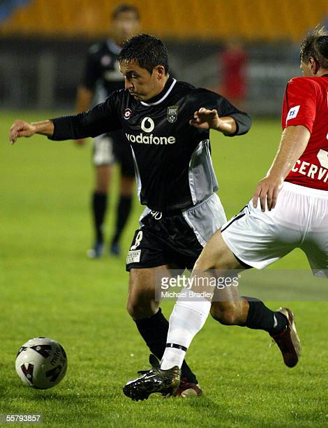Kingz Patricio Almendra looks to beat the tackle from Wolves David Cervinski during the NSL soccer match between the Football Kingz and the...