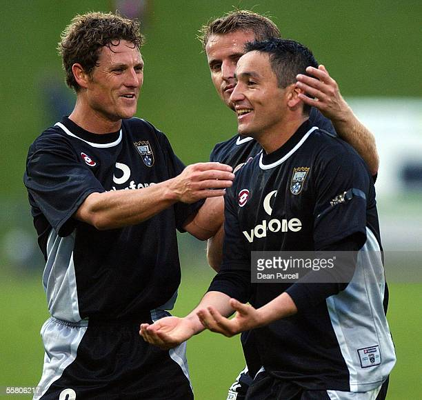 Kingz player Paticio Almendra celebrates a goal with team mates Mark Atkinson and Mark Beldham during the NSL Soccer match between the Kingz and...