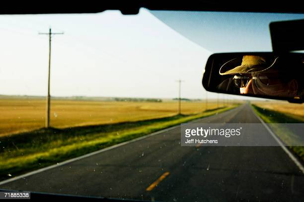 Kinney Adams, Senior Chase Guide, watches the American countryside go by through the rearview mirror of the tour group van he drives for his company,...