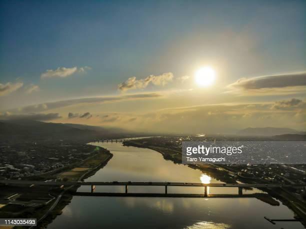 kinokawa river and sunrise - wispy stock photos and pictures