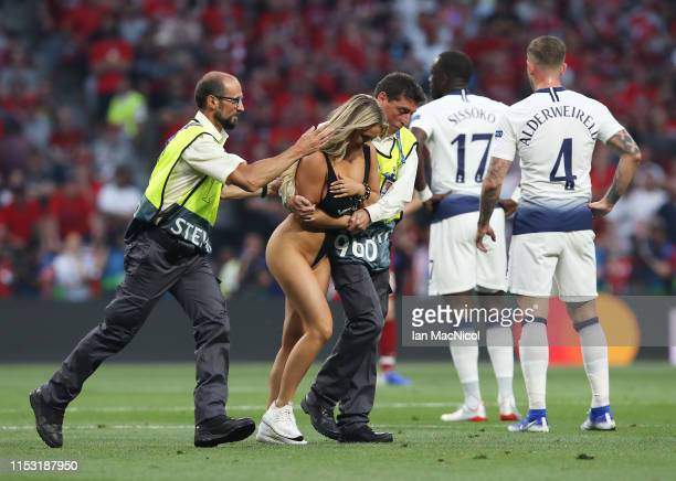 Kinsey Wolanski is led from the pitch during the UEFA Champions League Final between Tottenham Hotspur and Liverpool at Estadio Wanda Metropolitano...