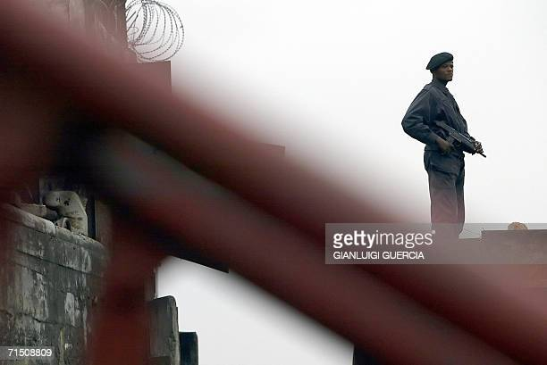 Kinshasa Democratic Republic of the Congo A Congolese policeman secures 24 July 2006 the perimeter of Kinshasa harbour The Democratic Republic of the...