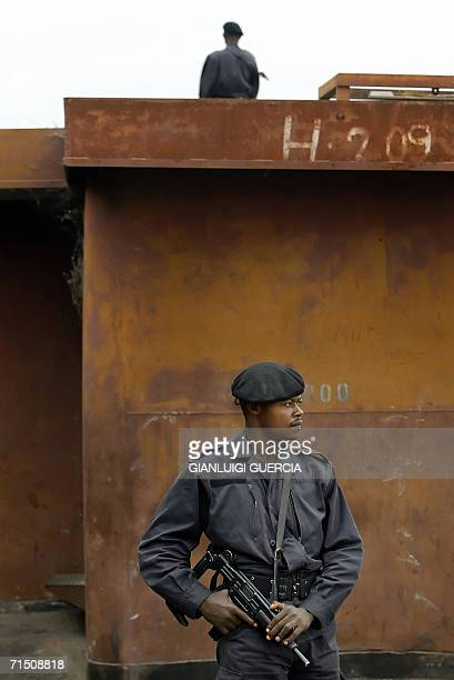 Kinshasa Democratic Republic of the Congo A Congolese policemen secure 24 July 2006 the perimeter of Kinshasa harbour The Democratic Republic of the...