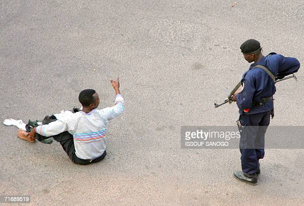 Kinshasa, Democratic Republic of the Congo: A guard of incumbent President Joseph Kabila arrests a man close to the Presidential Palace in central...