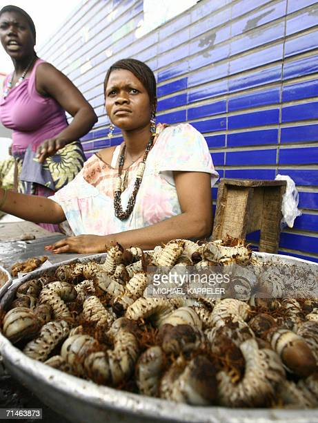 Kinshasa Democratic Republic of the Congo A woman sells maggots at the market of Kinshasa 15 July 2006 For the first time after 45 years former Zaire...