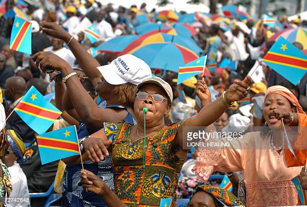 Kinshasa, Democratic Republic of the Congo: A woman waves the Congolese national flag during an inauguration ceremony for the new president Joseph...