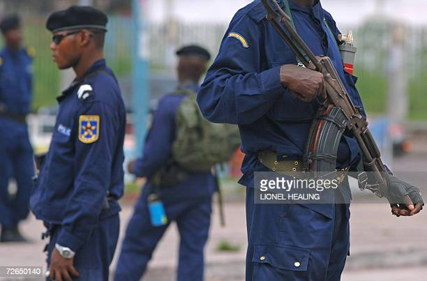 Kinshasa, Democratic Republic of the Congo: Policemen secure an area in the centre of Kinshasa, 27 November 2006. United Nations helicopters and...