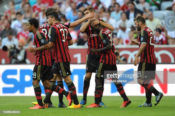 Kinsley Boateng of AC Milan celebrates with teammates after scoring 10 during the Audi Cup soccer third place match AC Milan vs FC Sao Paulo at...